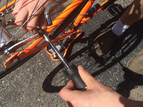 Unscrew the brake arm from the frame of the bicycle using the screwdriver.