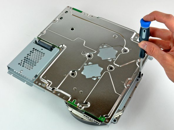 Image 2/2: The two identical matte finished brackets in the first picture are designed to apply pressure to the center of the processors, keeping them firmly planted on their heat sinks.