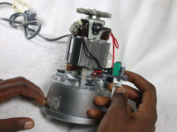 Image 1/1: Lift activator out of  the Magic Bullet housing while holding the spring with tweezers.