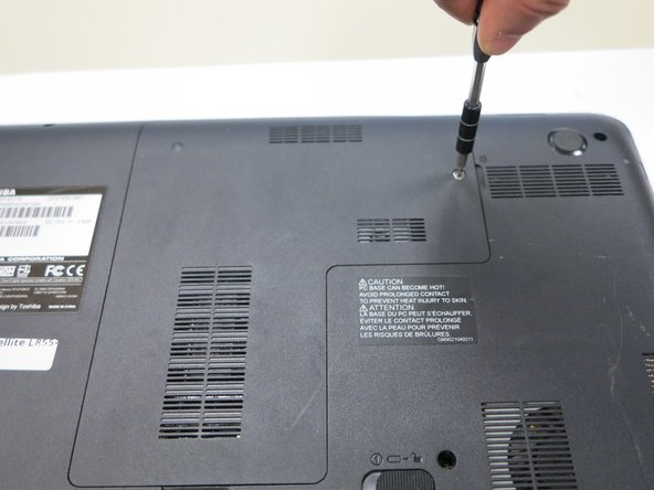 Use a Phillips #1 screwdriver to remove the screw holding in the back plate. This screw does not come out of the plate.
