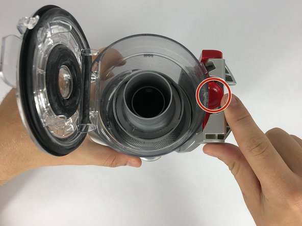 Locate the red lever below the vacuum.