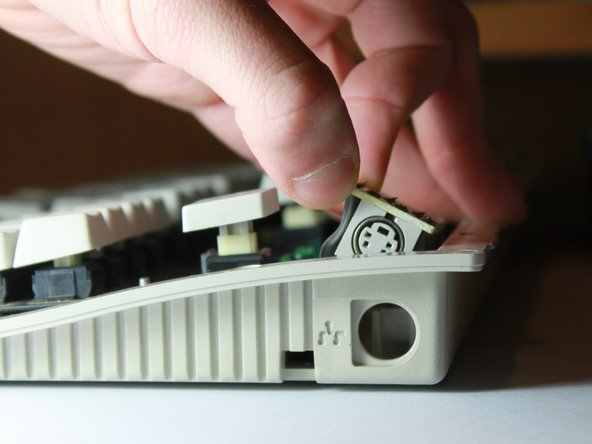 Image 3/3: When it's possible, grab the top of the green PCB and lift the board out of it's small mount.