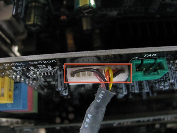 Locate and remove the white connector on the sound card by pulling on the black cable.