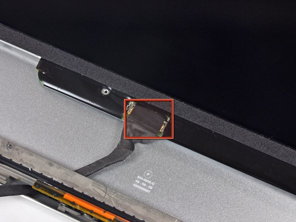 Peel the piece of tape covering the display data cable connector away from the edge closest to the LCD.