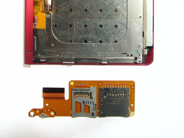 Image 2/2: Remove the SD/memory card holder from the device.