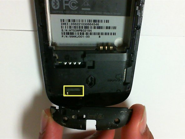 Use a pry tool or your fingers to remove the antenna cover and antenna component from the bottom of the phone.