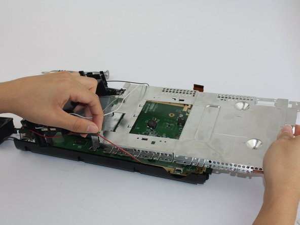 Using a Philips head (PH1) unscrew all floor screws connecting the outer plate from the circuit board to remove the circuit board.