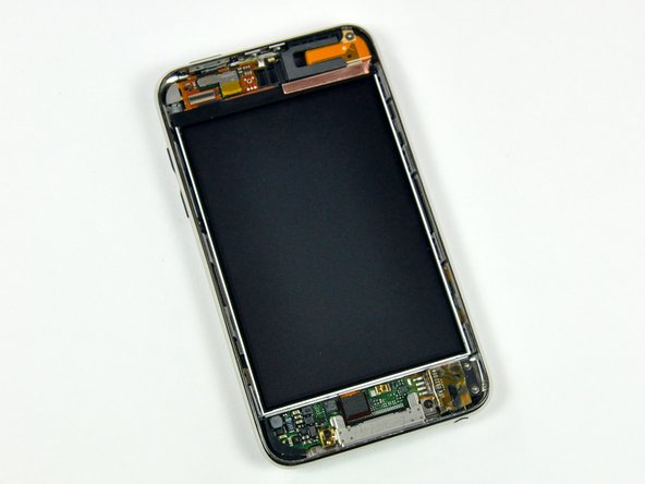 Image 1/3: You can see the silver metal retaining clips on the sides of the LCD. There are four clips on the right side, and three on the left.