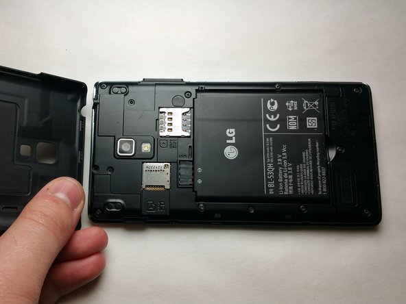 Begin the process with the device face down to remove the back cover. Remove the battery cover using your hands to access the inside of the phone.