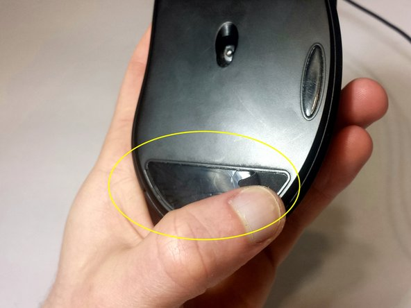 Remove the bottom mouse foot using a Jimmy and the same technique as in Step 1.