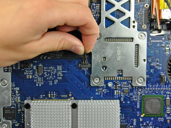 Disconnect the CPU fan from the logic board by pulling its connector toward the top edge of the iMac.