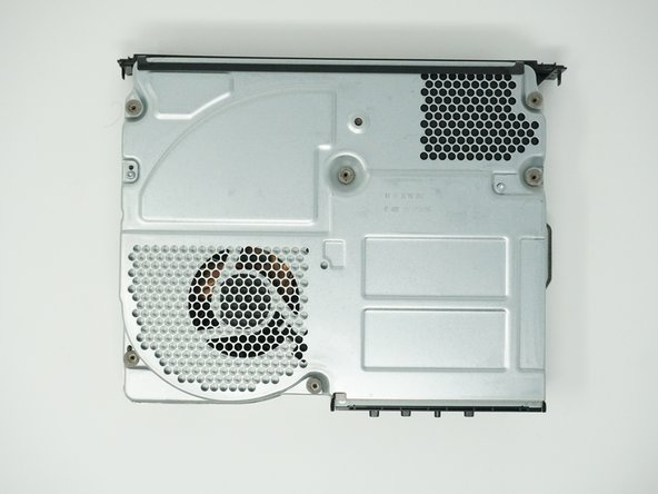 Lift the bottom of the case off of the Xbox by pulling it up and toward you.