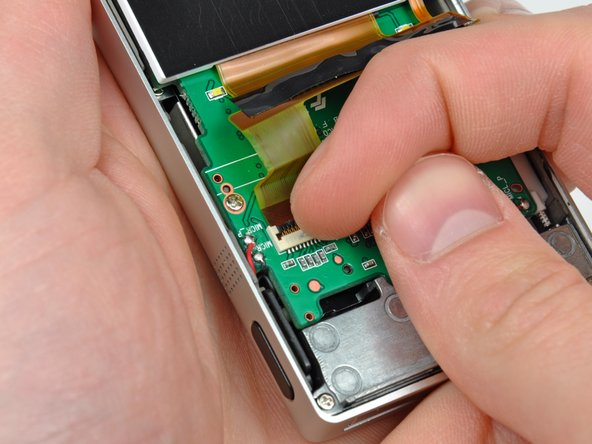 Image 1/2: Pull the display data cable out of its socket and remove the display.