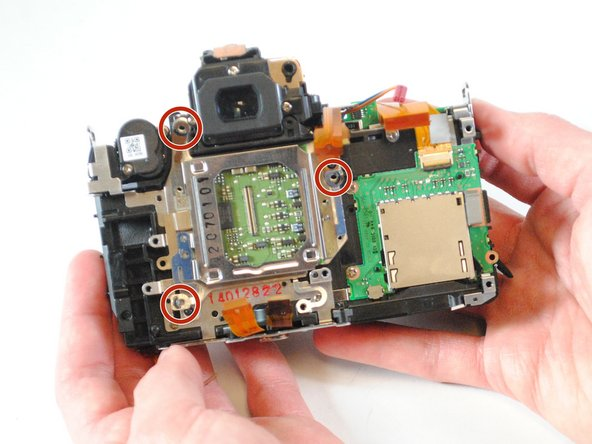 Remove the three silver 3mm Philips  #000 screws from the image sensor holder.