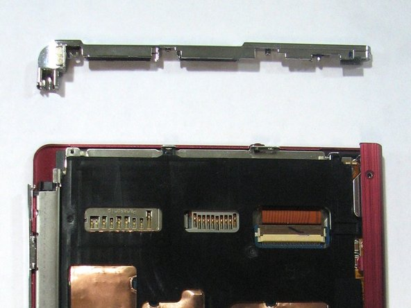 Pry apart off the top panel of the device.