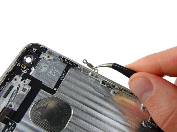 Grasp the metal bracket covering the power button switch with a pair of tweezers and remove it from the iPhone.