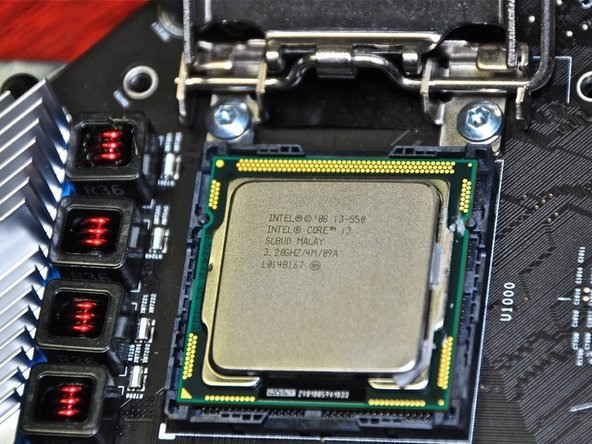 Image 1/3: Note arrow on CPU (bottom left in picture). New CPU must be installed in the same orientation.