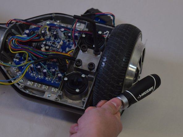 Make sure the replacement wheel is snug. Neither rubbing on the outer rim nor on the side of the hoverboard.