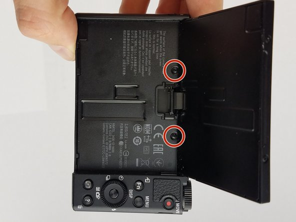 Image 1/1: Remove the two black M1.4 X 3.5 Phillips head screws using Phillips #000 screwdriver.