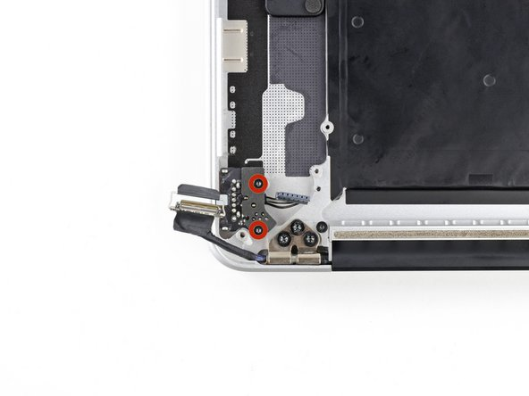 Remove the two 4.0 mm T5 Torx screws securing the MagSafe DC-In board to the upper case.