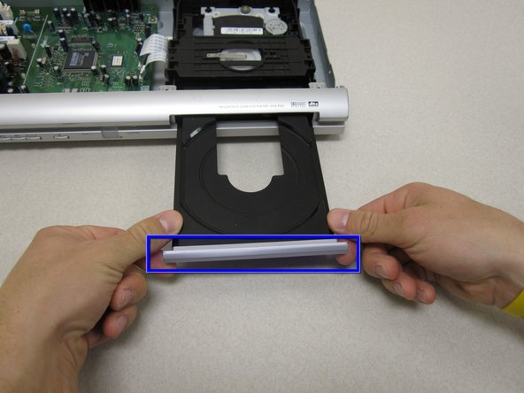 Image 2/2: Be careful not to crack or bend the disc tray by pulling too hard.