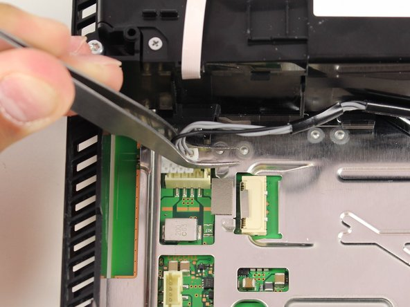 Unplug the optical drive cord from the motherboard.