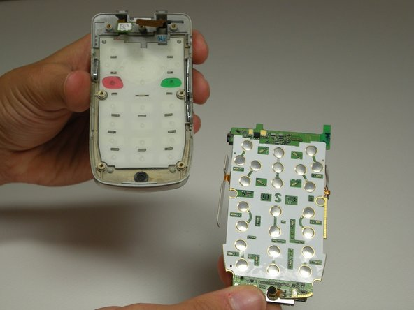 Insert replacement keypad with buttons aligned in proper holes.