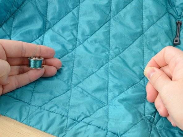 Image 2/3: Select thread that matches the fabric color on the lining of your jacket and [guide|10200|load it into the bobbin of your sewing machine].