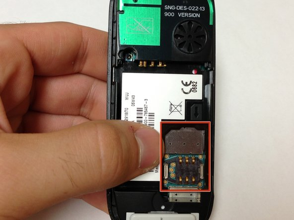 With the battery removed, locate the SIM card slot on the lower right side of the back of the phone. Gently slide the SIM card out from the slot.