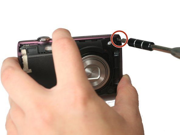 Using the Philips #000 head screwdriver, remove the 3.40 mm screw located on the front of the camera in the upper corner by the LED light.