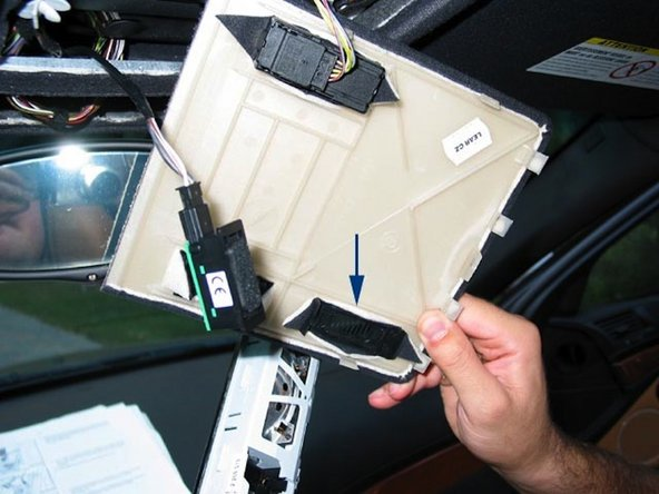 Image 1/1: To install the microphone simply remove the overhead console trim panel and connect the BMW microphone to the connector in the car and attach to the inside of the trim panel at the microphone mounting location
