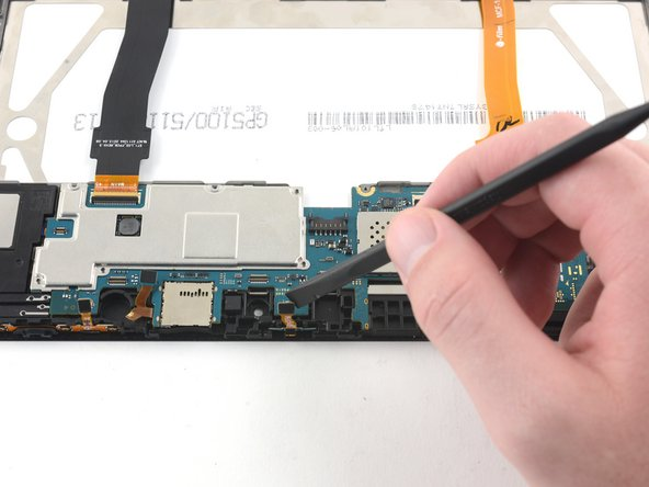 Remove the LED indicator light by gently pulling upward with nylon-tipped tweezers.