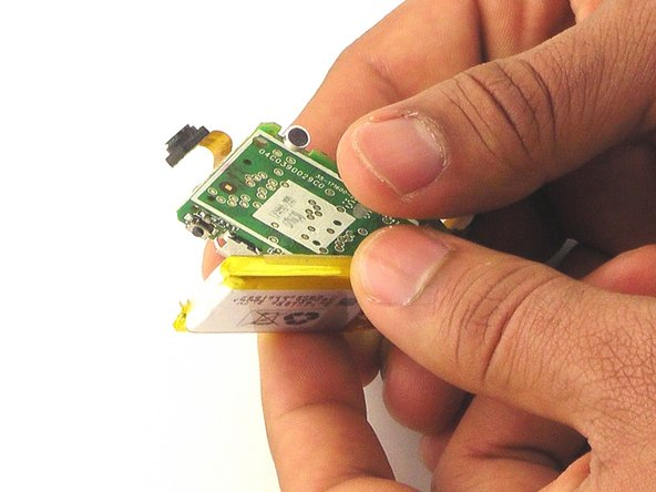 Image 2/2: There is a thin layer of adhesive holding the battery to the circuit board. This will remain sticky after prying.