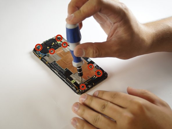 Remove all of the screw which are located on the backside of the phone with a #000 Phillip screw driver.