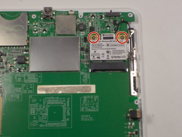 Using a Phillips #0 bit, remove the two 3mm screws at the top of the wireless card.