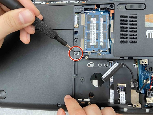 Use a Phillips #1 screwdriver to remove the single screw holding the optical drive