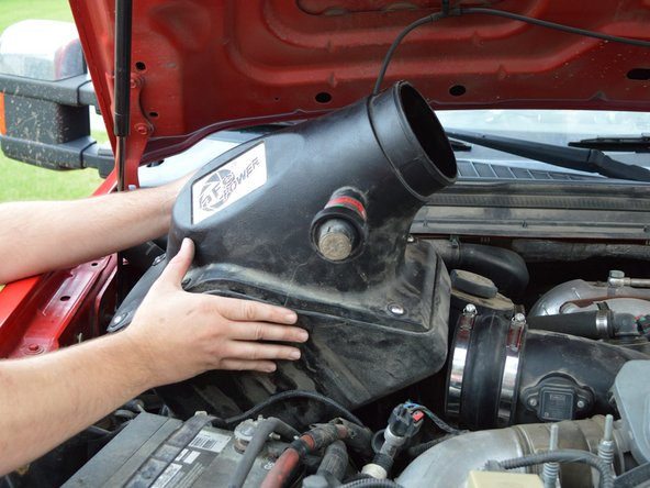 Pull air filter assembly out of vehicle.