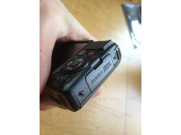 You only need one small cross screw head screwdriver to open up the camera. It takes 9 screws to take out the display.