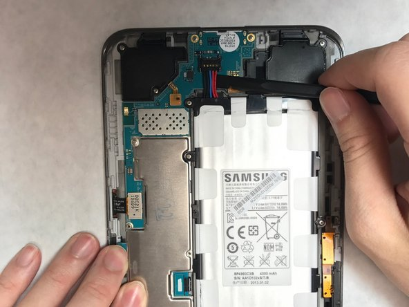 Image 2/3: Remove the battery and set it aside.