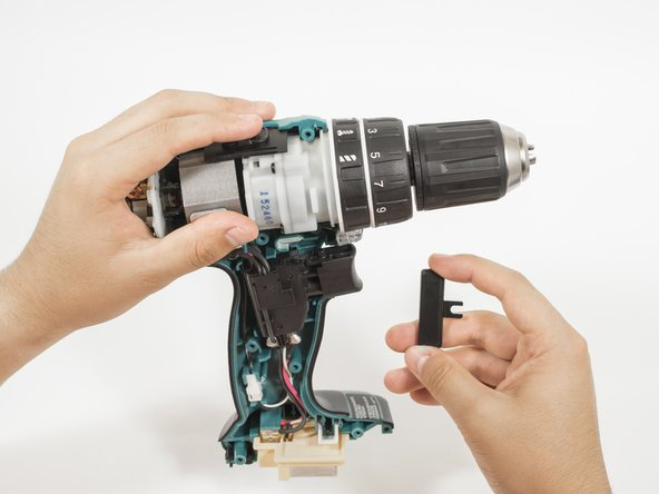 Image 2/2: Gently pull the forward/reverse switch to separate it from the trigger assembly.