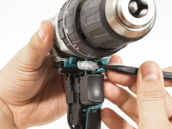 Use the pointed end of a plastic spudger to push the LED out of the drill.