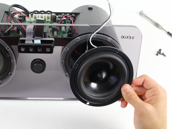 Remove the speaker from the iHome by feeding the black/white wires through the hole on the opposite side of the housing.
