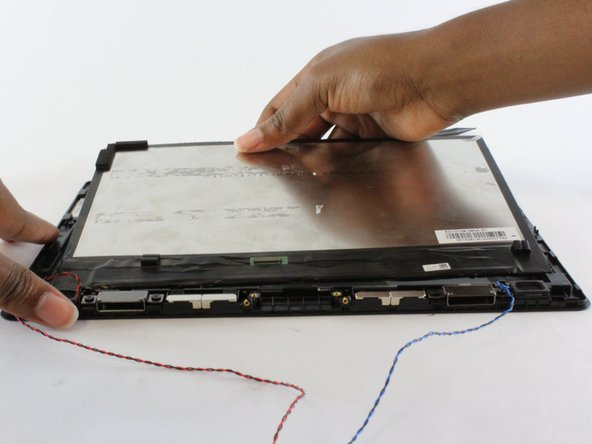 Once separated, gently lift away the LCD from the screen.
