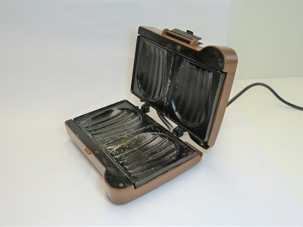 Unclip the black 'closing part' and open the toaster.