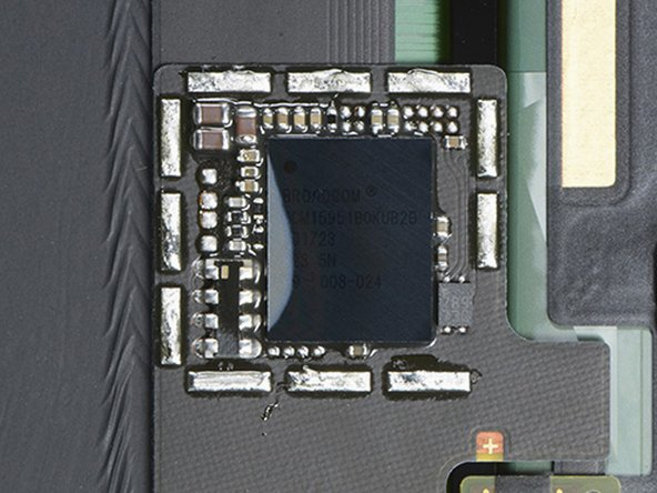 Time to get a look at that mystery chip! With a little help from our friends at TechInsights, we get a peek under the shields on the back of the display and find: