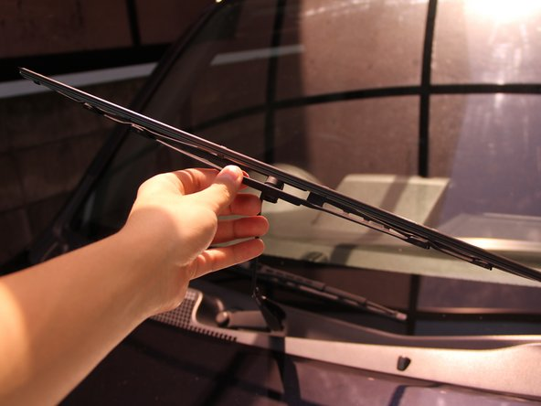 Rotate the wiper blade assembly so the replaceable blade faces outward.