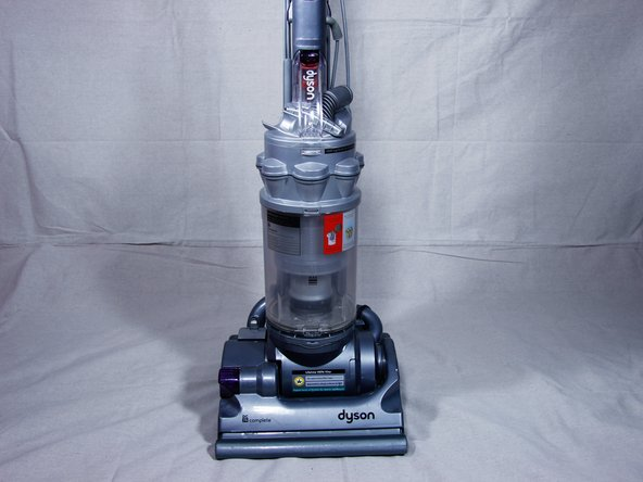 Place vacuum upright, with the canister facing you.