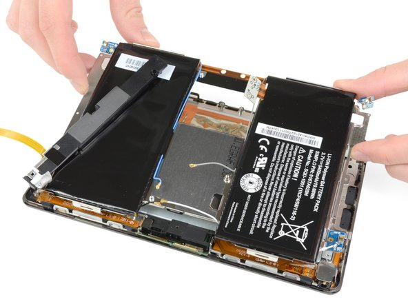 Image 1/3: Let's remove the mid-plane board, which houses the battery, left speaker, and antennas.