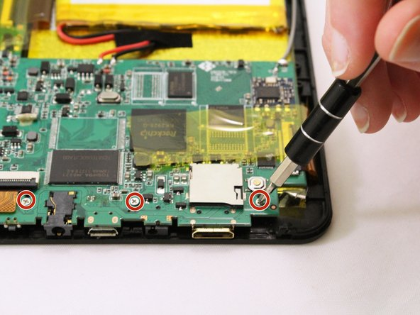 Use a PH00 screw driver to remove the three 4 mm screws holding the motherboard down.