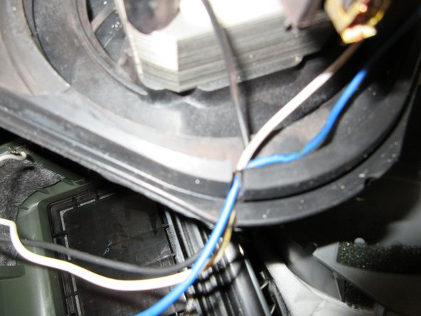 then put the white and the blue cable in place, there is also a second long black cable.